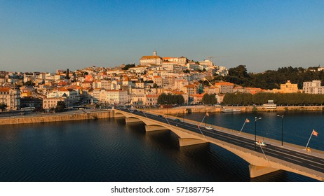 Aerial view of Coimbra, Portugal at sunset, with the oldest portuguese univeristy on top of the hill