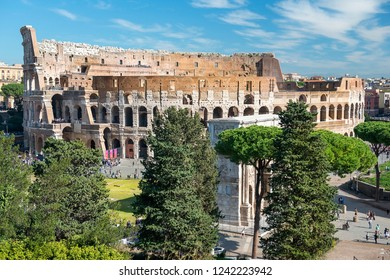 aerial view of the Coliseum or Flavian Amphitheatre (Amphitheatrum Flavium or Colosseo) and Arch of Constantine, Rome, Italy
