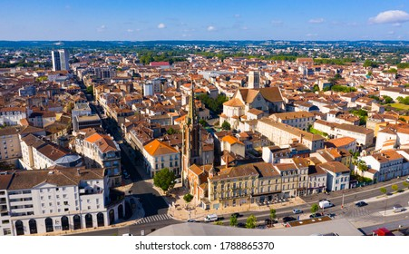 Aerial view of colorful Agen cityscape with Cathedral and Gothic steeple of church on sunny summer day, France