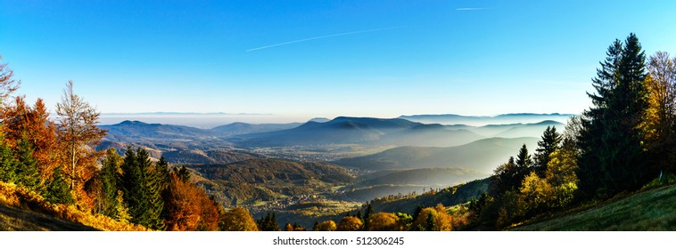 Aerial view of colorful autumnal mountains, foggy sunset, Vosges, Alsace, France