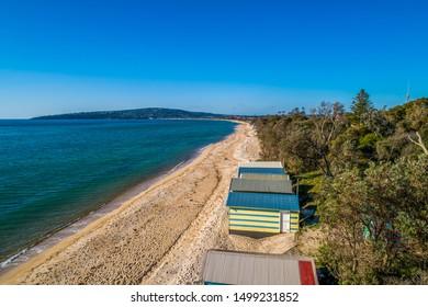 Aerial view of colorful beach huts and scenic coastline in Melbourne, Australia