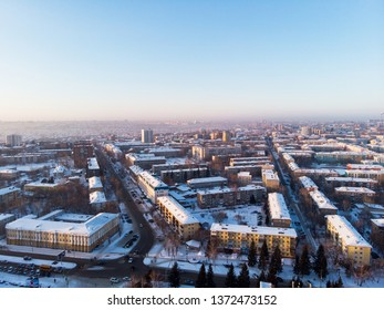 Aerial view of the colorful frosty winter evening and residential areas in Barnaul.