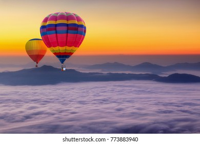 Aerial view from colorful hot air balloons flying over with the mist at Pha Tung mountain in sunrise time, Chiang Rai Province, Thailand