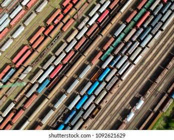 Aerial view of colorful trains on a station