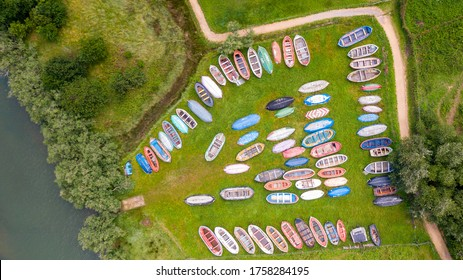 aerial view of colorful wooden boats stranded on a garden
