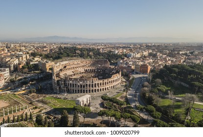 Aerial view of Colosseum at sunny day. Rome, Italy