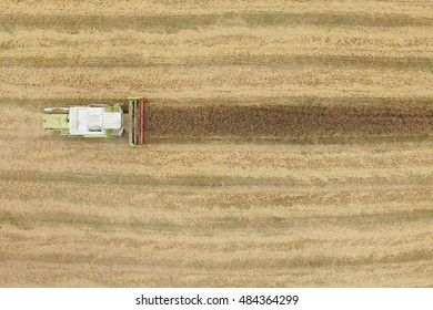 Aerial view of combine harvesting a fall corn field