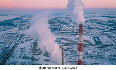 Aerial view of Combined heat and power plant in industrial zone. Cheboksary City, Russia. Heavy industry from above.