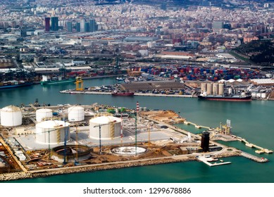 Aerial view of the commercial port of Barcelona seen from the window of an airplane. Barcelona, Spain, Europe