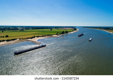 aerial view commercial ship crossing the River Rhine in an area of the Netherlands