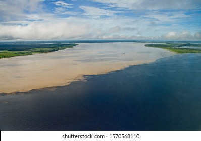 Aerial view of the confluence of the Rio Negro's water and the Solimoes River's water