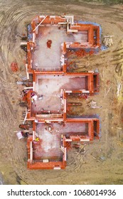 Aerial view of construction site new terraced houses. Construction industry from drone view.