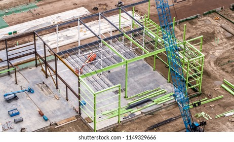 Aerial View of Construction Site, Steel Frame Construction and Blue Crane