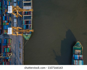 aerial view of Container Cargo freight ship with working crane loading bridge in shipyard for Logistic Import Export background