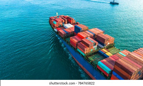 Aerial view container cargo ship, import export business logistic and transportation of International by ship in the open sea.