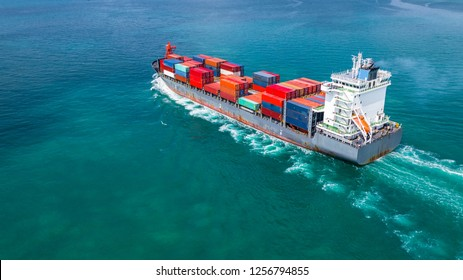 Aerial view container ship carrying container for import and export, business logistic and freight transportation by ship in open sea.