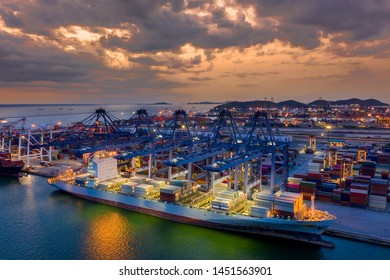 Aerial view. Container ship in pier with crane bridge carries out export and import business in the open sea. Logistics and transportation