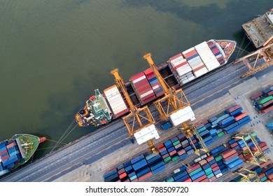 Aerial view of Containers yard in port congestion with ship vessels are loading and discharging operations of the tranport in international port.