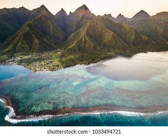 Aerial view of coral reef with The Mighty Mount Aorai in the back ground in Tahiti, French Polynesia.