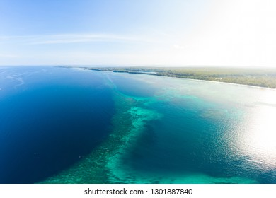 Aerial view coral reef scattered in caribbean sea, tropical beach islands. Indonesia Moluccas archipelago, Kei Islands, Banda Sea. Top travel destination, best diving snorkeling, stunning panorama.