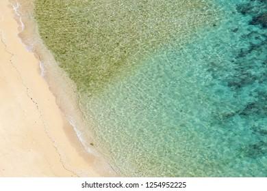 Aerial view of coral sea at Kafu-Banta in Miyagi-Island, Okinawa, Japan