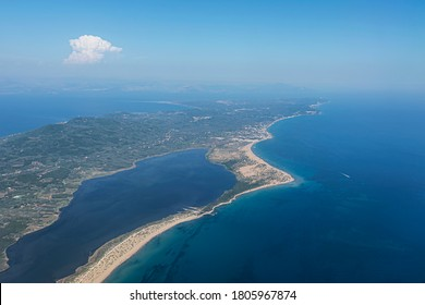 Aerial view of the Corfu island surrounded by turquoise water of the Adriatic sea. Greece 2020.