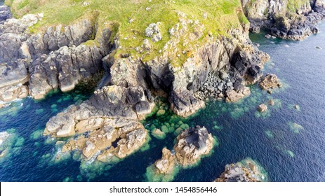 Aerial view of Cornish coastline with high cliffs, rocky shore near St Ives, Cornwall, south west England .