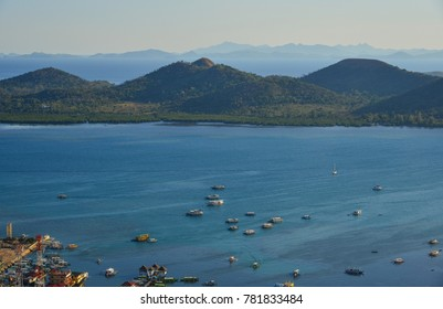 Aerial view of Coron Bay with boats at sunny day in Palawan, Philippines.