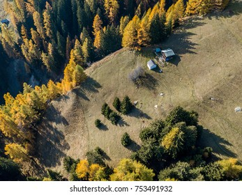 Aerial view of cottage in Swiss mountains in fall season