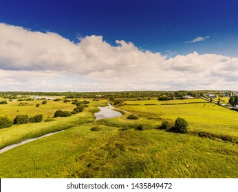 Aerial view, Country side landscape, Green fields, river Corrib, blue cloudy sky, County Galway.