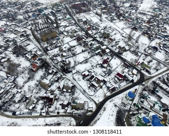 Aerial view of the countryside with the snow at winter time (drone image). February 8, 2019. Saburb of Kiev,Ukraine