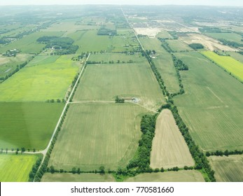 Aerial view of countryside in summer - green fields and farms, Ontario, Canada