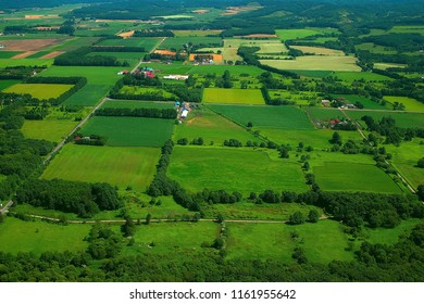 Aerial view of countryside, top view of farmland, farm field, village