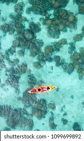 Aerial view of Couple canoeing or kayaking at sea island backdrop. Lipe Island, Thailand. Space for text