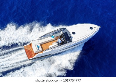 aerial view couple on luxury motor boat