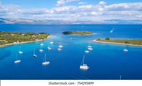 Aerial view of cozy mediterranean island. Blue lagoon, island paradise. Adriatic Sea of Croatia, popular touristic destination. Clear sea water.