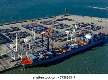 Aerial view of cranes, docks and cargo ship on the industrial 'Port of Coega' deep water port near Port Elizabeth