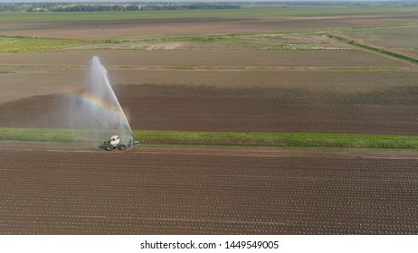 Aerial view of Crop Irrigation using the center pivot sprinkler system. An irrigation pivot watering agricultural land. Irrigation system watering farm land.