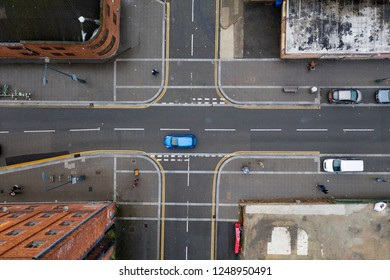 Aerial view of a crossroad junction in a town in the UK