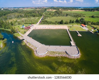 Aerial view of crowded sandy Mamry beach (Plaza Mamry in Polish) during hot summer day on Mamry Lake in Wegorzewo town, Mazury, Poland