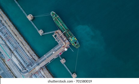 Aerial view crude oil tanker ship under cargo operations, Import export business and transportation by tanker business logistic.