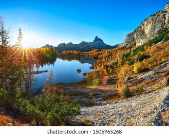 aerial view of  crystal clear Lake Federa in Dolomites Alps under sunlight. Fantastic autumn sunrise in Dolomites. Location: Federa lake with Dolomites peak, Cortina DAmpezzo, South Tyrol, Dolomites,