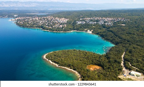 Aerial view of crystal clear water off the coastline inisland Krk, Croatia.