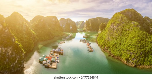 Aerial view of Cua Van floating fishing village and rock island, Halong Bay, Vietnam, Southeast Asia. UNESCO World Heritage Site. Junk boat cruise to Ha Long Bay. Famous destination of Vietnam