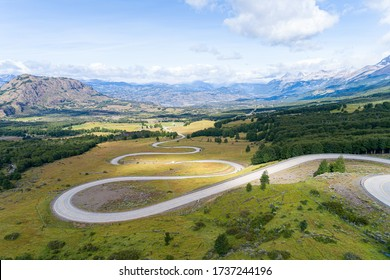 Aerial view of the curved asphalt road trough mountains. Carretera Austral road near the Cerro Castillo National Park. Chile