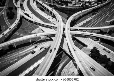 Aerial View of Curved Modern Architecture of Highways and Interchange urban sprawl abstract Drone angle monochrome adventure straight down view from drone of loops and interchanges