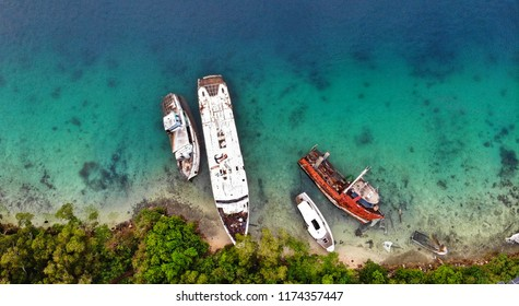aerial view of cyclone damage of damaged yachts and ships washed ashore from cyclone pam. Hurricane devastation on a tropical island in Vanuatu