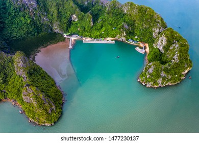 Aerial view Dau Go cave at Ba Hang floating fishing village, rock island, Halong Bay, Vietnam, Southeast Asia. UNESCO World Heritage Site. Junk boat cruise to Ha Long Bay.Famous destination of Vietnam