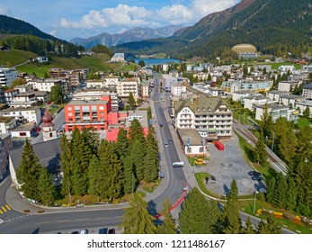 Aerial view of Davos city and lake. Davos is swiss city, famous location of annual meetings of World Economic Forum.