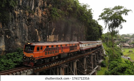 """Aerial view Death Railway """"Krasae cave"""", Tourist Train on The Bridge of the River Kwai at Kanchanaburi Thailand. Tourism atmosphere after unlocking the Covid-19 situation in Thailand."""